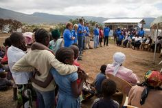 Home dedication for Habitat's 500,000th house built worldwide. Volunteers + tithers from Paterson Habitat (NJ) speaking at celebration in Maai Mahiu, Kenya. Sept. 2011