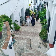 """""""Photo time for bride and groom in the picturesque little streets in the mountain village of Frigiliana. Perfect for the weather and the photo opportunities. Fab backdrop for any photographs.  #spain #frigiliana #wedding #bride #groom #spanishsun #photo #photography #backdrop #stunning #street #pictureday #weddingplanner #wednesdaymotivation #celebrant #marriage #love #samesex"""" by @bceo_info. #свадьба #невеста #prewedding #casamento #marriage #noiva #bridalstyle #weddingfashion #weddingdream…"""