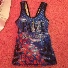 Fame allstars practice wear tank top and shorts Fame allstars tank top: bling 11 on the M of FAME! Super cute wish it fit me otherwise I wouldn't be selling it! That's the only reason I'm selling it is because it is to small :( There is a small hole where the seem ripped on the left side of the tank top can be fixed with a few stitches hardly noticeable!!! Top is a size small and shorts are size medium…