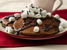 Hot chocolate with a twist---in pancakes that is! Bisquick®, chocolate milk, baking cocoa and a bit of sugar make them extra easy. Add your favorite hot chocolate toppings for an awesome breakfast or brunch treat.