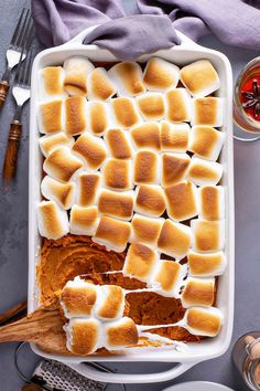 This delicious Sweet Potato Casserole recipe is a family favorite. It's loaded with marshmallows, butter, cinnamon and a secret ingredient to create the best Thanksgiving side dish ever! #sweetpotatocasserole #sweetpotatocasserolerecipe #sweetpotatocasserolewithmarshmallow #thanksgivingsidedish Sweet Potato Casserole Recipe With Marshmallows, Best Sweet Potato Casserole, Recipes With Marshmallows, Sweet Potato Recipes, Sweet Potatoe With Marshmellows, Loaded Sweet Potato, Bean Casserole, Best Thanksgiving Side Dishes, Thanksgiving Casserole