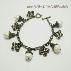 Handmade freshwater pearl bracelet in antique bronze chain. Inexpensive and so chic!  Like is on facebook www.facebook.com/sonnamabead