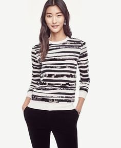 """Shimmering sequins add sparkling personality to our rich zebra jacquard sweater. Jewel neck. Long sleeves. 22 1/2"""" long.  CH - Could be a good update to the sequin sweater?"""
