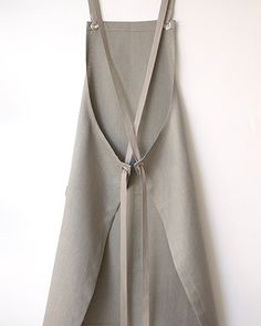 An irresistible combination of neutrality and boldness, this granite gray linen apron and the punch of a bright citron towel make a most remarkable set. Sewing Aprons, Sewing Clothes, Apron Pattern Free, Dress Patterns, Sewing Patterns, Sewing Ideas, Linen Apron, Kitchen Aprons, Apron Dress