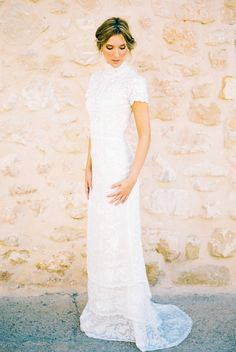 Odile wedding dress. Cotton. Hand embroidery. Cap sleeves. High neckline. High collar. Beautiful vintage style french cornelli lace. Open back. Tiered gown.