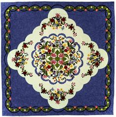 """The 2011 Raffle Quilt is ""Summer Garden"". It was designed by June Bradley and Carol Schaefer. The quilting design is by Helene Knott. The quilt is hand-quilted, hand-appliquéd by our guild members. The quilt measures approximately 112"" by 112""."""