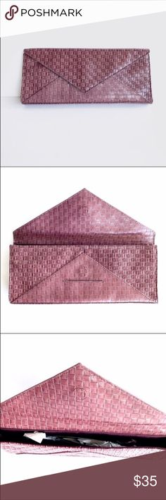 "Lulu Townsend Woven Envelope Statement Clutch NWOT Lulu Townsend Woven Envelope Clutch, in Wine, adorable, easy to carry, and can be used to dress up any outfit. NWOT  Length: 12 1/4""   Width: 1 1/2""   Depth: 5"" Lulu Townsend Bags Clutches & Wristlets"