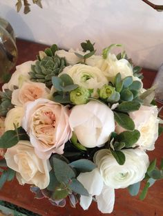 Spring bridal bouquet, blush pink, white and mint green. Ranunculas, succulents, peonies, eucalyptus and David Austin Kiera roses. Surrey wedding flowers by Boutique Blooms floral design.