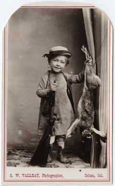 ca. 1855-95, [carte de visite portrait of a small child with a shot gun and a dead rabbit], George W. Valleau