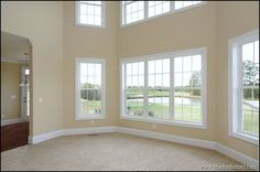 This great room is completely open and bright - with entire window walls.