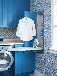 Maximize your laundry room's potential by installing a drop-down ironing board behind a paneled door. The shallow compartment includes electrical outlets, hooks, and even a shelf for spray bottles.