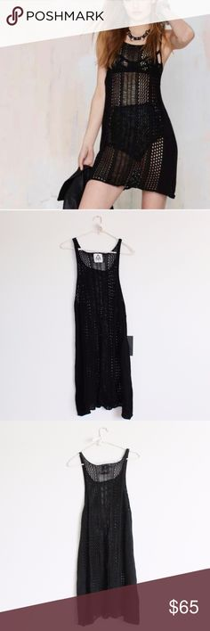 NWT UNIF Crochet What's Up Hello Lace Black Dress New with tags UNIF crochet dress / cover up. Black. See through. Size Medium. Short length.  PLEASE NOTE: last picture shows a pull on the back of the dress. UNIF Dresses Mini
