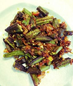 Achari bhindi - This is a quick and easy okra recipe. Fry okra fingers (bhindi) in oil and set aside. In a separate wok, heat up oil and add ginger garlic paste, curry leaves and chopped tomatoes. Fry for a few minutes. Add Shan/National Achar gosht masala. Now fry and add a splash of water to cook the tomatoes. Once the tomatoes are tender and the masala separates, add the fried Okra. Let it simmer for few minutes. Serve with daal and rice.