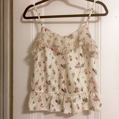 AE Floral Peplum Blouse Peplum blouse with floral pattern from American Eagle Outfitters. I offer discounted bundles! Make me an offer or comment below to let me know you're interested 😄 American Eagle Outfitters Tops Blouses