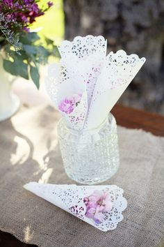 Lace (doily) petal cones: Cute DIY idea! Fill it with candy wrapped in plastic or tulle, and these could be the wedding favors.