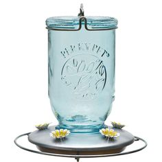 Gift Idea: A beautiful Mason Jar Hummingbird Bird feeder! Hang it up and tie a bow on it for a sweet surprise!