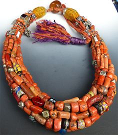 Coral Berber Necklace - The necklace is one of the finest pieces of Berber tribal jewelry we have ever seen.  It's beautifully constructed out of a rich amalgam of antique coral, Berber silver beads, and various antique glass African trade beads.  The color of the coral is magnificent.  The necklace has a number of different silver pieces woven into the necklace as well.  Much of the silver is high-quality antique Berber silver, although a couple of the pendants hanging off appear to...