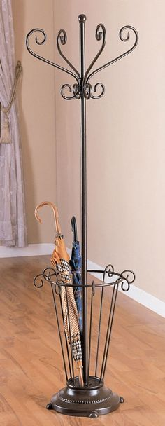 This metal frame umbrella stand coat rack exudes an abundance of Victorian charm & elegance! The rack is finished in deep black, accentuating its appealing wrought iron style scrollwork. Four gracefully curved coat hooks top the tall rack. Iron Furniture, Steel Furniture, Rack Metal, Wrought Iron Decor, Metal Bending, Iron Work, Metal Crafts, Blacksmithing, Metal Art