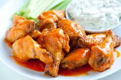 Who doesn't love the taste of spicy hot wings? For a crowd-pleasing appetizer or main course, try this recipe for Super Easy Hot Wings, one of the tastiest chicken wing recipes we've come across. Serve with a healthy dose of blue cheese dressing! Wings In The Oven, Oven Hot Wings, Super Bowl Essen, Crispy Baked Chicken, Easy Baked Chicken Wings, Fried Chicken, Albondigas, Easy Chicken Recipes, Thai Recipes
