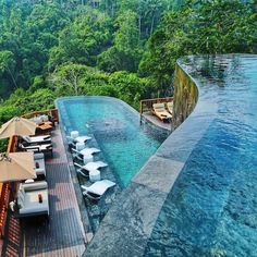Hanging Gardens of Bali, Indonesia. This resort features one of the most beautiful infinity pools ever, giving swimmers the unique… Unique Hotels, Beautiful Hotels, Beautiful Places, Cheap Hotels, Beautiful Sky, Wonderful Places, Hotel Swimming Pool, Hotel Pool, Voyage Bali