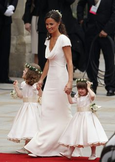 Pippa's dress was also lovely. What an interesting tradition of the Maid of Honor wearing white...Beautiful!