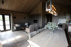The new leisure cabin at Norefjell's west side offers wonderful sun and a great view of the scenery. The complex consists of a main house with accompanying a. Maine House, Great View, Living Room, Cabins, Table, Interiors, Furniture, Home Decor, Modern