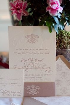 A beautiful customization of our Plume design featuring hand calligraphy accents by Debi Zeinert, a beautiful belly band and the family crest was used throughout the invitation suite!