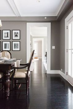 This home was once a farmhouse in the Historical District in Barrington, Illinois. With the help of a fantastic architect, who specializes in historical preservation, the family worked to create a gorgeous home while adhering to the architectural standards of the historical district. Grey walls, white trim, black floors and gorgeous black and white photography of the family! See more of this house Tour: A Modern Farmhouse-Style Historic Home   Apartment Therapy