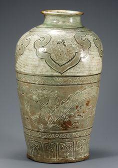 (Korea) Buncheong Porcelain Jar with inlaid Dragon & stamped design. Joseon Kingdom, Korea. circa early 15 century CE. National Treasures #259. H 45.9cm.  National Museum of Korea. 분청사기 구름 용무늬 항아리