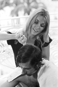 Sharon Tate gives her husband Roman Polanski a grooming in their hotel room at the Cannes Film Festival, photo by Jack Garofalo, 1968.