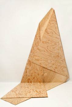 "Artist: Harry Roseman Title: Folded Plywood 15 Materials: AC 1/4"" plywood (constructed from a single piece of plywood) Dimensions: 61.5""x39""x42"" Year created: 2012"