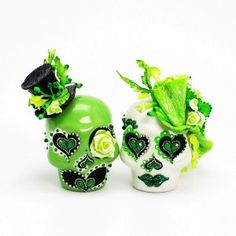 Day of the Dead skull cake toppers (but in our wedding colours).  My Favorite Color