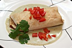 Whenever I go to Chuy's , I order the Chuychanga with Deluxe Tomatillo Sauce. When I saw this recipe for oven baked Chimichangas , I was i. Tomatillo Chicken, Tomatillo Recipes, Tomatillo Sauce, Gourmet Recipes, Mexican Food Recipes, Cooking Recipes, Mexican Dinners, Turkey Recipes, Sauce Recipes