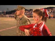 [VIDEO] U.S. Navy Petty Officer Surprises Cheerleader Daughter on Field  |  Petty Officer Dale Williams made a surprise visit to his daughter, Kendall. Williams hid behind the Color Guard as his daughter stood on the football field with her cheerleading squad. Just before the national anthem, the announcer introduces her father!