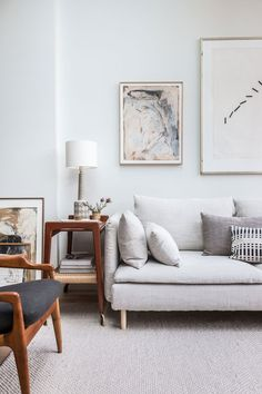 This stunning living room belongs to Holly of Avenue Design Studio | She's kept it light and neutral with dark wood accents and carefully layered textiles | Seen here an IKEA Söderhamn sofa with a Bemz cover in Natural Brera Lino linen by Designers Guild
