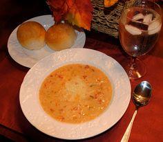 Tomato Basil Parmesan Soup | http://www.thesisterscafe.com/2010/11/tomato-basil-parmesan-soup-2