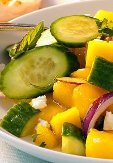 Mango and Cucumber Salad - This light, refreshing dish can be on the tabl e in 15 minutes.   #Minutes #Mix #cool #favorite #try #best #backing #cucumber