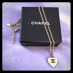 Chanel enamel charm necklace Authentic Chanel necklace. Enamel heart charm features classic Chanel logo on one side and a flower on the other. Chain  has Chanel tag as well. Comes with original box. From the Spring 2006 collection. CHANEL Jewelry Necklaces