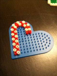 Candy Cane perler bead idea with heart pegboard