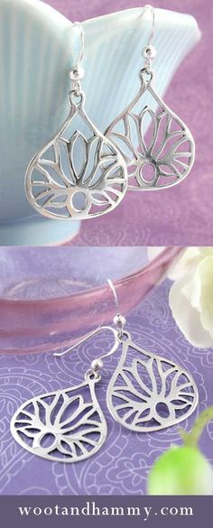 Large Teardrop Shaped Lotus Earrings. On first glance you may not even notice that these pretty earrings are lotus flowers.The teardrop shaped border subtly changes the character of the lotus, which is so recognizable by its many tapered petals. When confined by a border, the flower becomes a little more abstract, an ornamental pattern within the overall earring. Lotus Flowers, Silver Flowers, Fabric Flower Necklace, Flower Jewelry, Wedding Rings Teardrop, Diamond Flower, Diamond Are A Girls Best Friend, Abstract, Pretty
