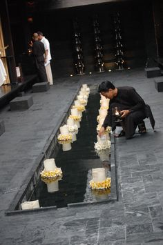 floating candles with frangipani flowers