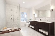 Contemporary Master Bathroom with complex marble tile counters, frameless showerdoor, Double sink, High ceiling, Flush