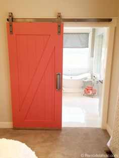Barn Door to Bathroom in Master Bedroom. I'd paint it pale coral and mount a framed mirror behind where the door is when it's open.