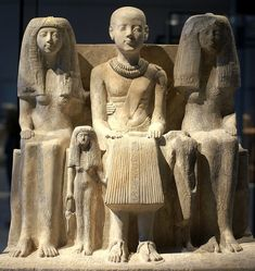 Ptahmai with his wife Hatshepsut and her daughter right Inuihaj left. _ 19th dynasty
