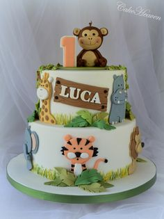 My last cake for 2014 was a joint effort with my niece for her son's first birthday. The party's theme was Jungle and the colours on the cake matched exactly the invite for the party. I got my inspiration for this cake from a cake entitled 'Jungle. Jungle Birthday Cakes, Jungle Safari Cake, Jungle Theme Cakes, Baby First Birthday Cake, Animal Birthday Cakes, Safari Cakes, Safari Baby Shower Cake, Jungle Party, Safari Theme