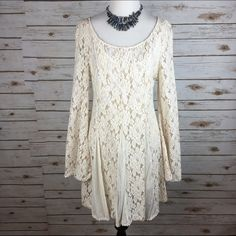 "[Free People] Boho Lace Beaded Dress Gypsy Glam Beautiful bohemian style lace dress. Soft and cozy knit. Iridescent beading accents the chest. Long bell sleeves. Swingy style. Wide scoop neckline. Pullover style with keyhole at back of neck. Stretchy slip included. Dotted mesh triangles in skirt. Great for fancier events or can be dressed down.  Fabric: 66% Cotton 34% Nylon  Bust: 18"" Length: 34"" Condition: EUC. No flaws.  No Trades! Free People Dresses Long Sleeve"