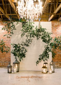Romantic Greenery Wedding Ceremony Backdrop Romantic Greenery Wedding Ceremony Backdrop White, candlelight and greenery for the perfect wedding ceremony backdrop in an industrial wedding venue. Wedding Ceremony Ideas, Backdrop Wedding, Reception Backdrop, Indoor Wedding Ceremonies, White Backdrop, Backdrop Decorations, Wedding Decorations, Backdrop Ideas, Industrial Wedding Venues