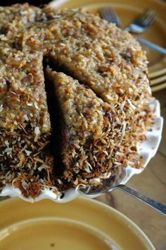 Toasted Coconut German Chocolate  Cake from The Adventure Bite. Toasting the coconut makes it light and crunchy. Such a beautiful cake!