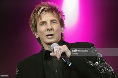 Barry Manilow performs on stage at the BBC Proms In The Park at Hyde Park on September 12, 2009 in London, England.