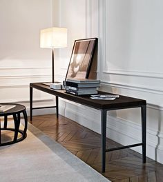 Black vignette table by Antonio Citterio, wonderful wooden floor and those walls...